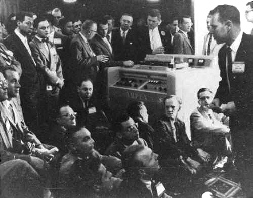 The Ampex Mark IV prototype Quad Videotape Recorder is demonstrated to CBS television network affiliate representatives at the Conrad Hilton Hotel, Chicago, April 1956