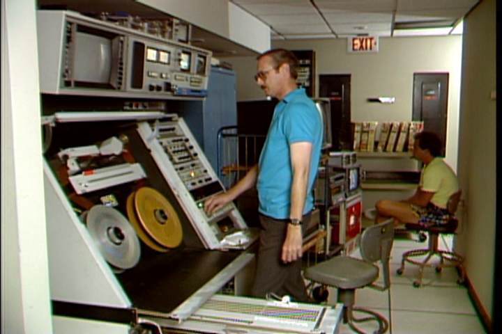 Don Kent operates Ampex AVR-1 donated to UCLA by KTLA, Los Angeles during 1988 transfer of very early color videotapes recorded at NBC, Burbank in 1958-1960 with the RCA Labs color process. These Quad Tapes were transferred to D-2 digital tapes and then edited into digital master tapes. Image capture via Don Kent from KTLA News videotape.