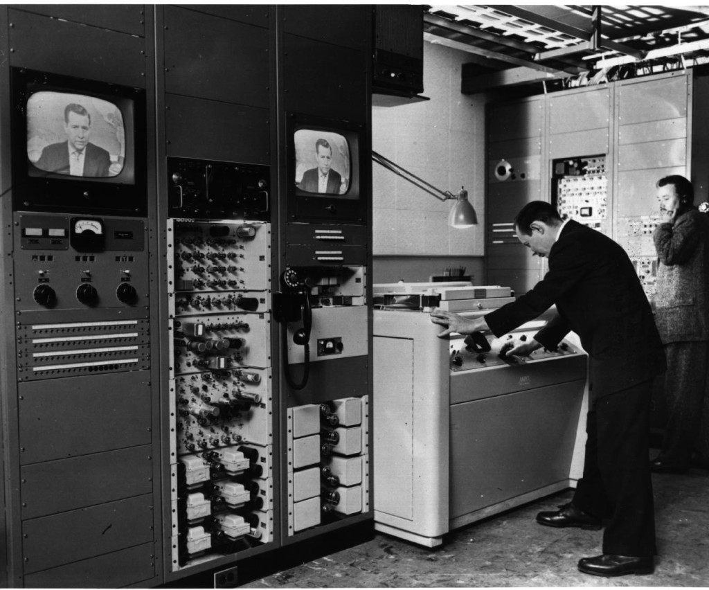 Engineer John Radis monitors operation of Ampex VRX-1000 at CBS Television City in Hollywood as Douglas Edwards reports the news in New York.